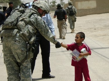 U.S. soldier provides pens to Iraqi boy