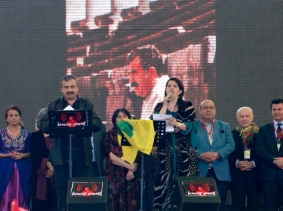 Pro-Kurdish politicians read the statement of jailed Kurdish rebel leader Abdullah Ocalan ordering his fighters to cease fire and withdraw from Turkish soil during a gathering to celebrate Newroz in the Turkish city of Diyarbakir on March 21, 2013, photo by Umit Bektas/Reuters