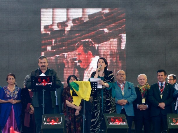Pro-Kurdish politicians read the statement of jailed Kurdish rebel leader Abdullah Ocalan ordering his fighters to cease fire and withdraw from Turkish soil during a gathering to celebrate Newroz in the Turkish city of Diyarbakir on March 21, 2013