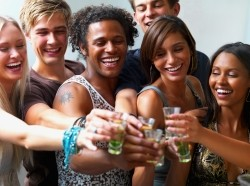 teens making a toast with shots