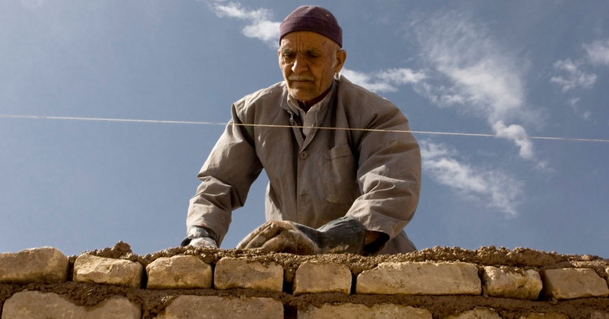 An Iranian worker builds a wall in Aradan, east of Tehran, March 12, 2008