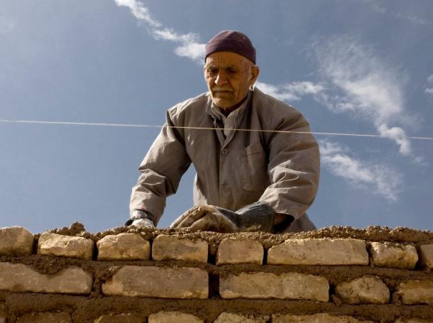 An Iranian worker builds a wall in Aradan, east of Tehran, March 12, 2008