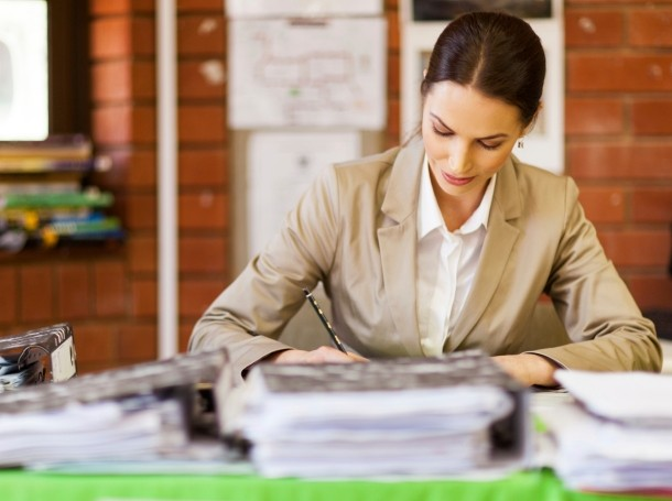 woman reviewing papers in an office