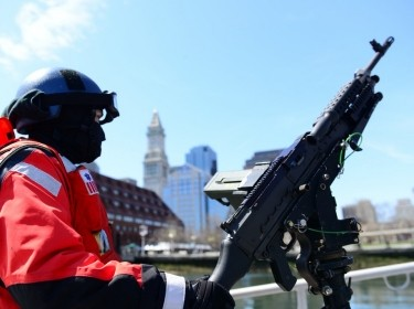 A crew member from Station Boston conducts security zones in the Boston Harbor