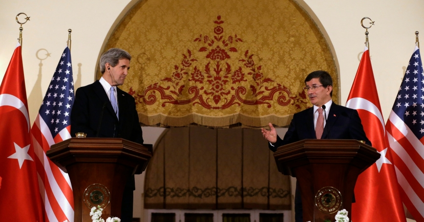 U.S. Secretary of State John Kerry and Turkish Foreign Minister Ahmet Davutoglu at a news conference in Ankara, March 1, 2013