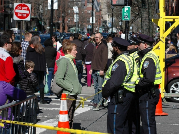 a woman talking to Boston police near site of Marathon bombings