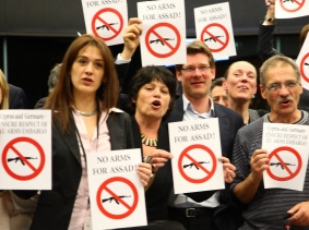 Europeans with 'No Arms for Assad' signs