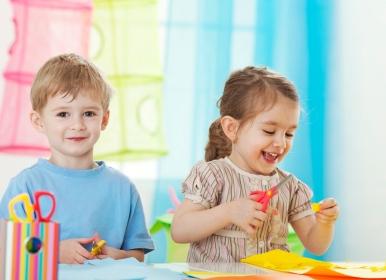 preschool boy and girl being creative