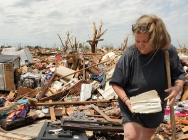 Moore, Okla. resident looking through remains of her house that was detroyed by the tornado