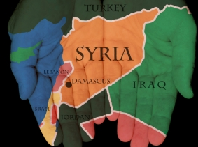 map of Syria on open hands