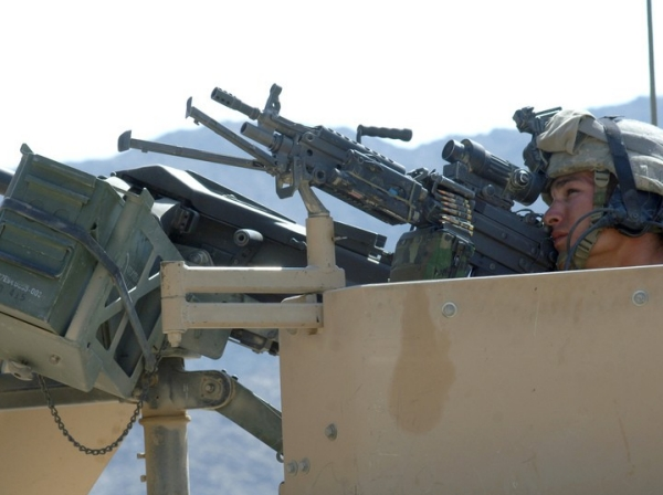 U.S. Army soldier pulls security as coalition forces search Ala Say Valley, Afghanistan