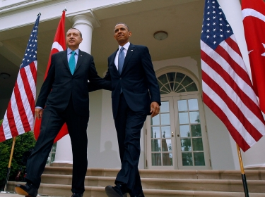 Turkish Prime Minister Recep Tayyip Erdogan and U.S. President Barack Obama arrive for a joint news conference in the White House Rose Garden in Washington, May 16, 2013