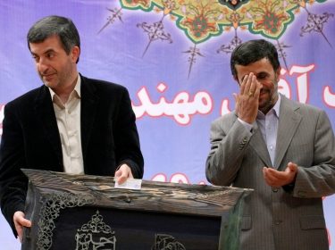 Iran's President Mahmoud Ahmadinejad (R) and First Vice President Esfandiar Rahim Mashaei attend a ceremony in Tehran July 22, 2009