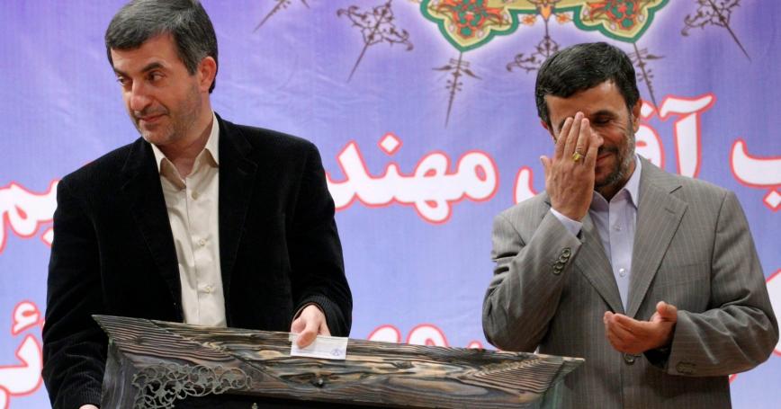 Iran's President Mahmoud Ahmadinejad (R) and First Vice President Esfandiar Rahim Mashaei attend a ceremony in Tehran July 22, 2009