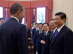 President Barack Obama and Vice President Joe Biden talk with Vice President Xi Jinping of the People's Republic of China and members of the Chinese delegation following their bilateral meeting in the Oval Office, Feb. 14, 2012.