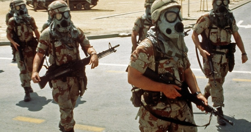 Soldiers wearing their M-17A1 protective masks while conducting training during Operation Desert Shield