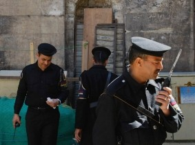 Egyptian policemen on guard by the entrance to the Ayyubid 13th century Madrasa of al-Salih Ayyub in Cairo, Egypt, photo by EdStock/iStock