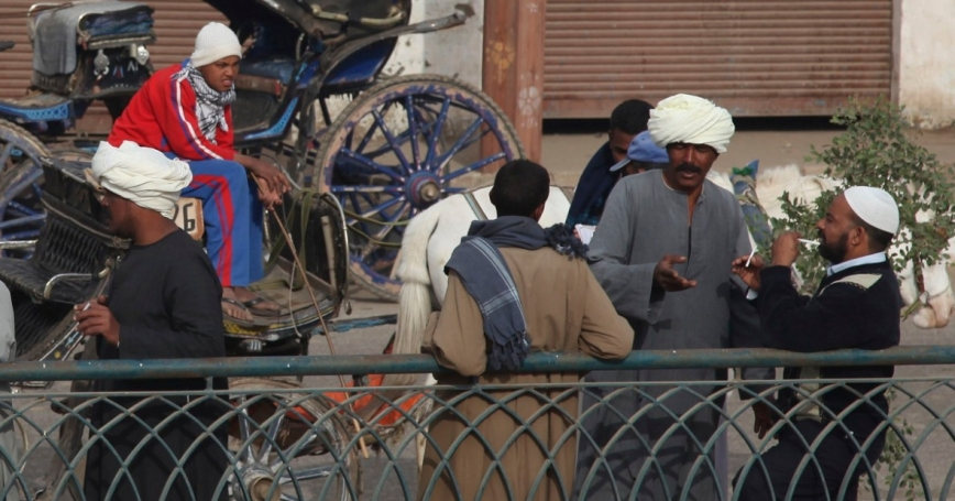 Egyptian men talking in Idfo, Aswan, EG, January 2013