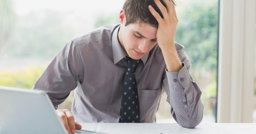 Stressed businessman getting headache