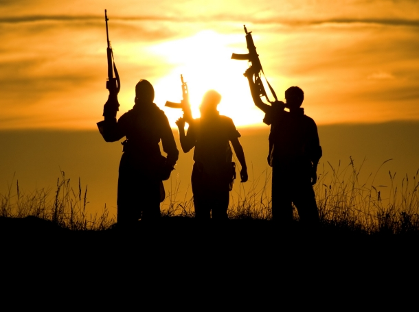 Silhouette of soldiers against sunset
