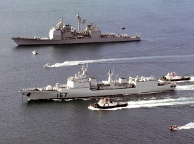 The USS Chancellorsville leads the Peoples Liberation Army Navy destroyer Shenzhen into Apra Harbor, Guam in 2003