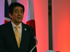 In a photo from June 2013, Shinzo Abe speaks to an audience in London, England about Japan's economic revival.