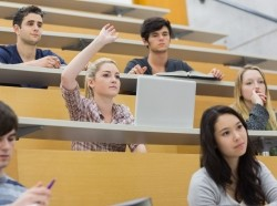 college students having a lesson in a lecture hall