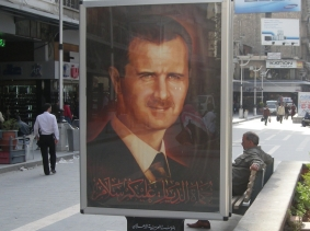 A portrait of Syrian President Bashar al-Assad on display in a public square in Aleppo, Syria