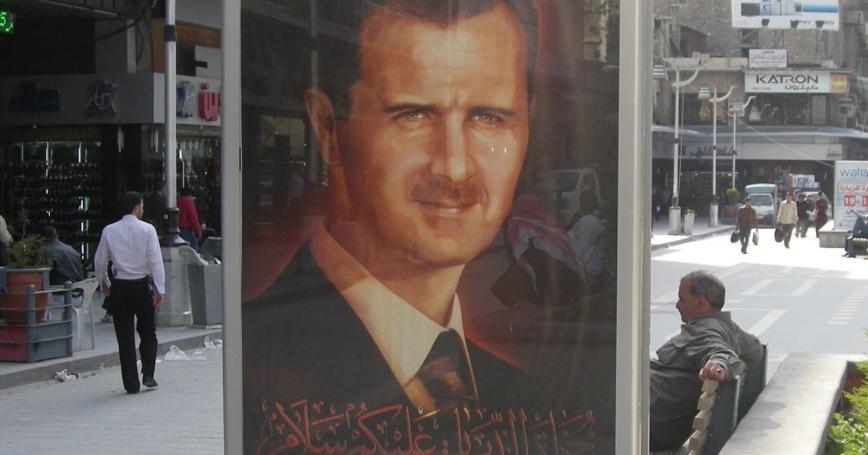 A portrait of Syrian President Bashar al-Assad on display in a public square in Aleppo, Syria