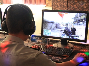 "PLA soldier plays ""Glorious Mission Online"" an online game that allows players to defend contested islands in the East China Sea"