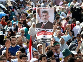 Supporters of the Muslim Brotherhood and ousted Egyptian President Mursi protest in Cairo August 23, 2013