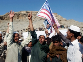 Afghan men shout anti-U.S. slogans during a demonstration