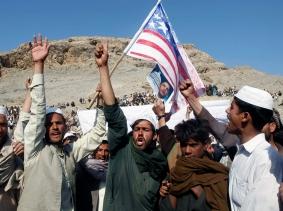 Afghan men shout anti-U.S. slogans during a demonstration