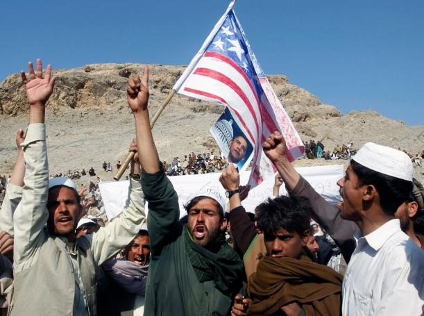 Afghan men shout anti-U.S. slogans during a demonstration in Jalalabad province February 24, 2012