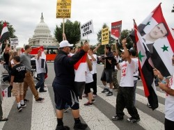 Syrian Americans rally in support of the Bashar al-Assad regime and against proposed U.S. military action against Syria