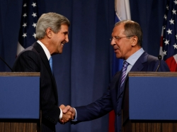 U.S. Secretary of State John Kerry shakes hands with Russian Foreign Minister Sergey Lavrov.