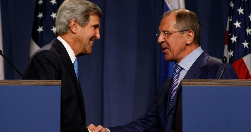 U.S. Secretary of State John Kerry shakes hands with Russian Foreign Minister Sergey Lavrov