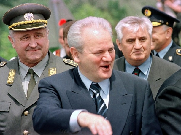 Ousted Yugoslav President Milosevic (center) with Yugoslav Defence Minister Ojdanic (left) and Serbian Police Minister Stojiljkovic (right) June 14, 1999