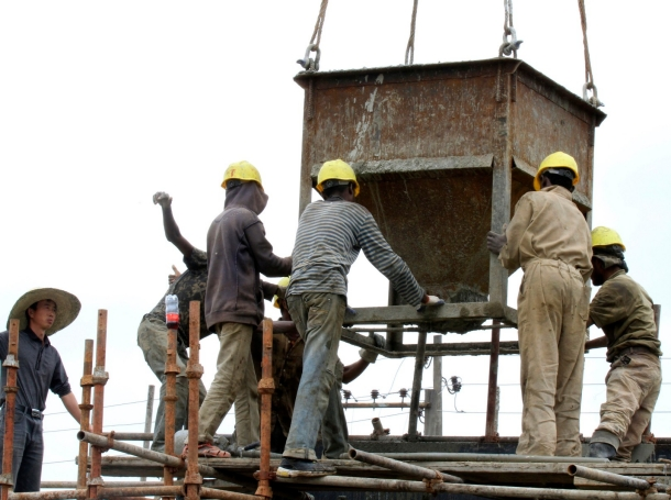 Labourers work at a railway station construction site in Ethiopia's capital Addis Ababa