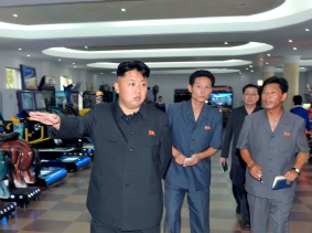 North Korea's leader Kim Jong-un visits a newly built video games room at the amusement house of the Rungna People's Pleasure Park