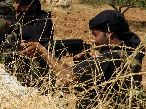 Free Syrian Army fighters aim their weapons during clashes with forces loyal to Assad