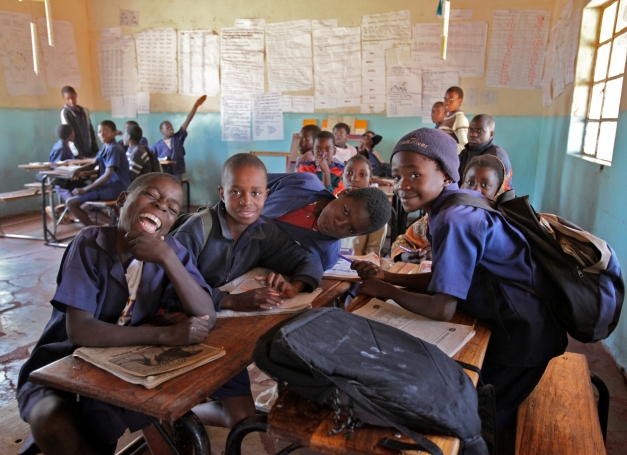 Student smile for a photo in their Zambian schoolhouse