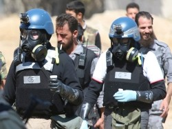 U.N. chemical weapons experts investigating a gas attack that killed hundreds of civilians in the suburbs of Damascus