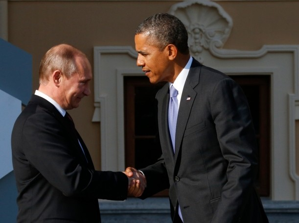 Russia's President Vladimir Putin welcomes U.S. President Barack Obama before the first working session of the G20 Summit on September 5, 2013