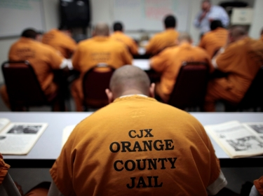 Inmates sit in a classroom at the Orange County jail