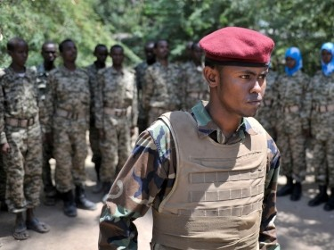 Somali National Army soldiers stand at attention in a training camp