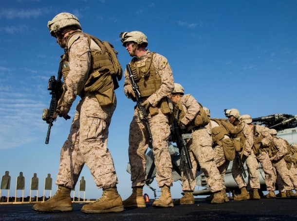 U.S. marines during a live-fire exercise on the flight deck of the amphibious transport dock ship USS San Antonio
