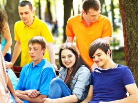 young people having a group discussion in a park