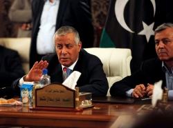 Libya's Prime Minister Ali Zeidan addresses a news conference after his release on October 10