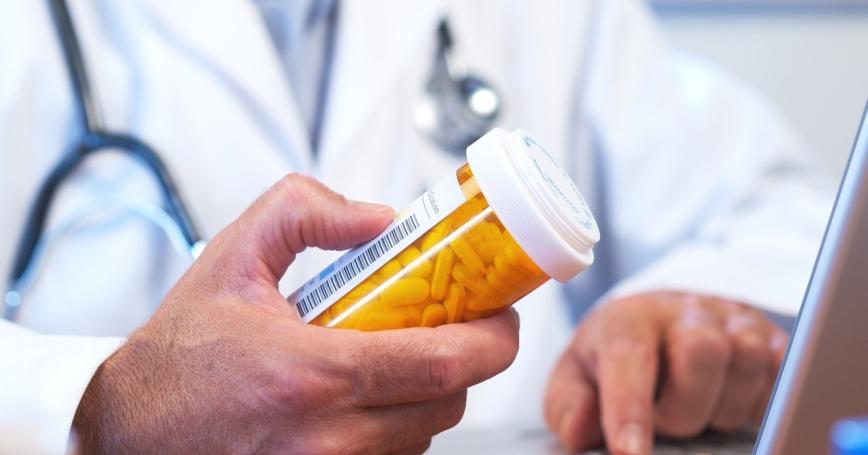 Doctor preparing online internet prescription